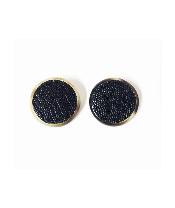 Black Horn round clip earrings set with black ostrich leather