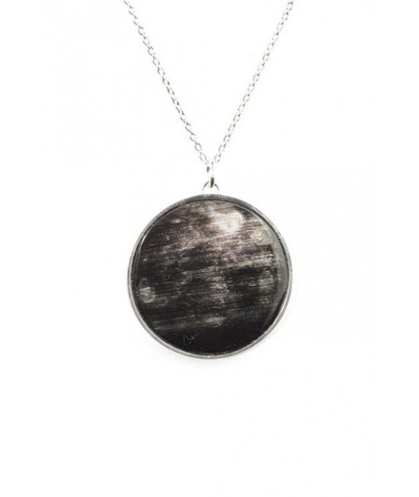 Marbled black horn medallion pendant set in silver and with a silver chain