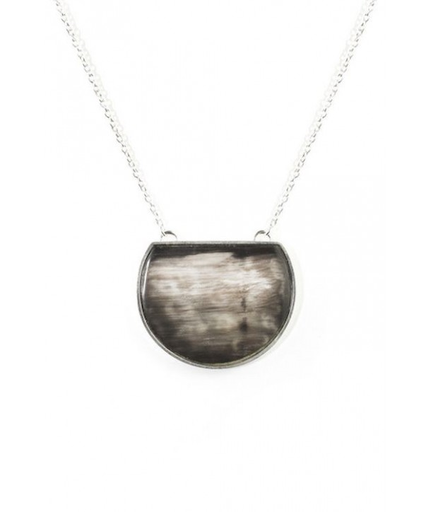 Truncated marbled black horn disc pendant set in silver and with a silver chain