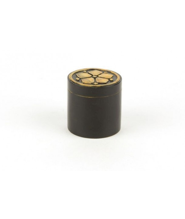 Rosette pattern pill box in stone with black background