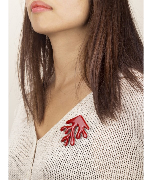 Red lacquered coral brooch