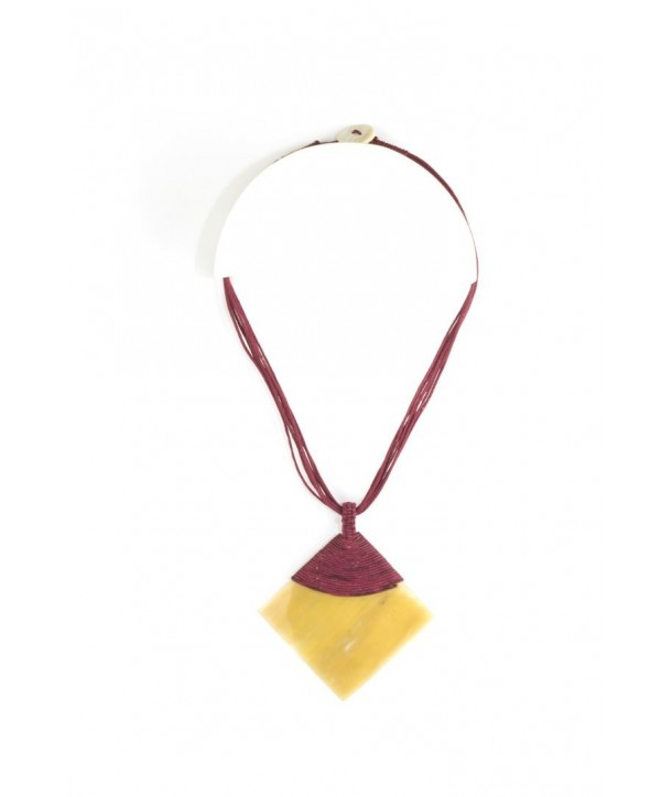 Blond horn rhombus pendant sheathed in burgundy cotton